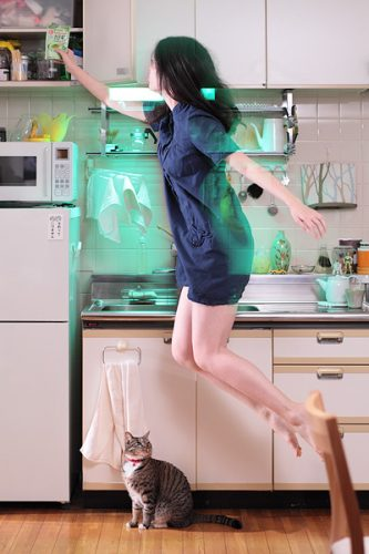 girl floating in the kitchen