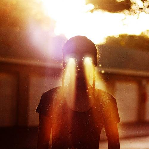 girl with light pouring through her eyes