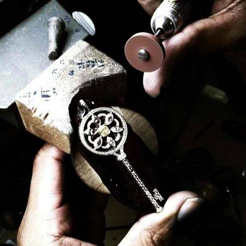 artisan making a key