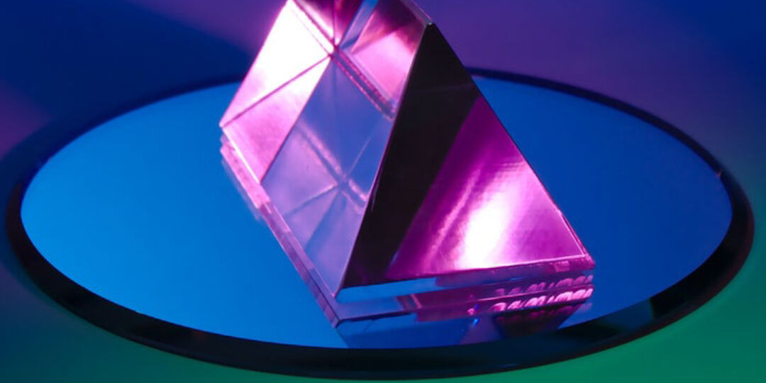 pink triangle prism on a round mirror